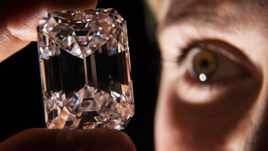 An employee holds the 100-Carat perfect diamond at Sotheby's auction house.